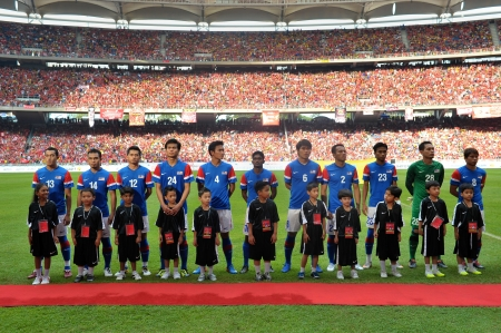 KUALA LUMPUR - JULY 16 : Malaysia team line-up during a friendly match against Malaysia on July 16, 2011 in Kuala Lumpur, Malaysia. Liverpool won 6-3.