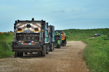 Garbage Trucks on their way to landfill photo