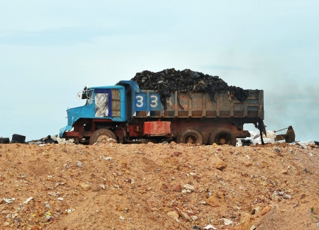 Garbage Trucks work on the landfill photo