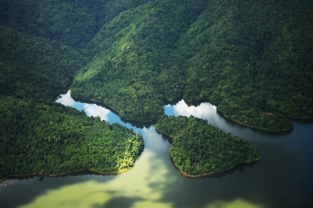 arial views: Rain Forest mountain and lake, Kedah Malaysia - arial view