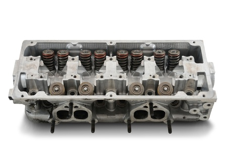 Four cylinder engine head on white