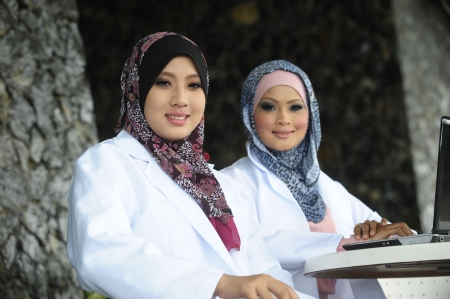 Two Women Doctor With Scarf, Outdoor  Stock Photo