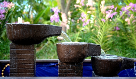 stone fountain with water fall decoration photo