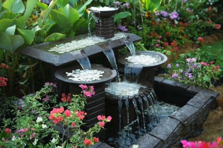 stone fountain with water fall decoration