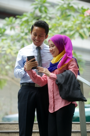 Young asian couple use cell phone
