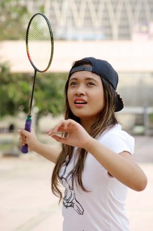 アジアの女の子遊びバドミントン
