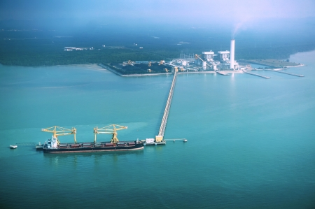 aerial: Oil Tanker at refinery plant                                Stock Photo