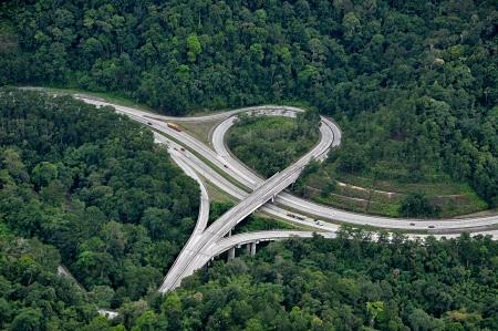 Highway interchange in rain forest - Aerial View 写真素材