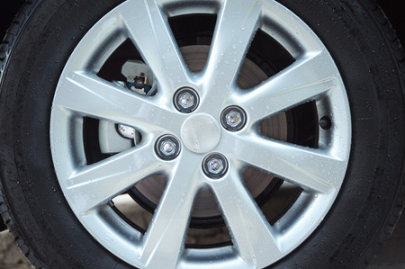 Wet car wheel and brake disk  photo