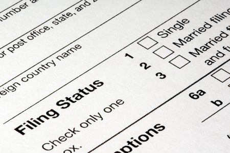 The Filing Status section of a 1040 income tax return form. Stock Photo