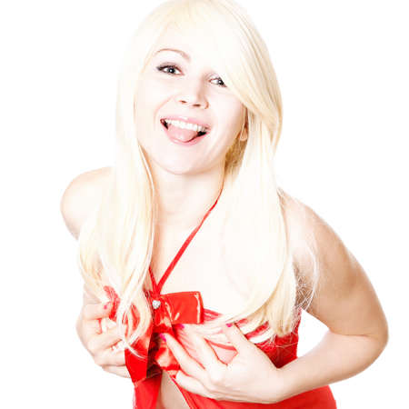 Young blonde in red top teasing with her tongue out; isolated on white photo