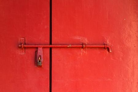 old lock and red door