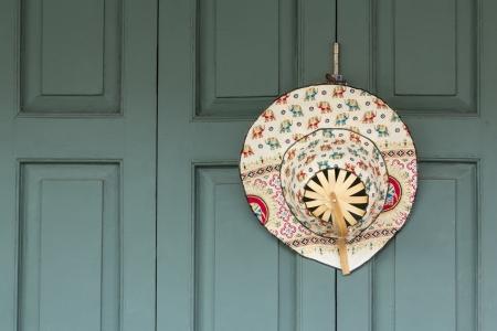 headgear hanging on the wooden door
