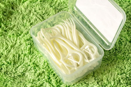 Toothpicks on green fabric