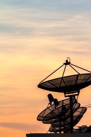 silhouette Satellite dish on twilight time Stock Photo
