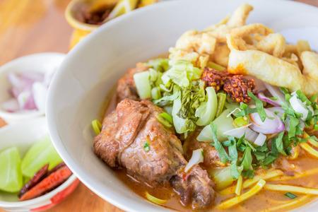 Noodle Khao soi , Thai food on wood background