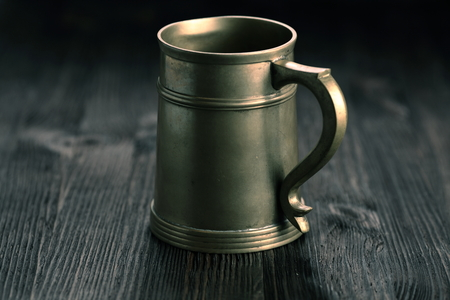 pewter mug: Old Pewter Mug on a wooden table