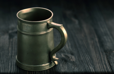 pewter: Old Pewter Mug on a wooden table