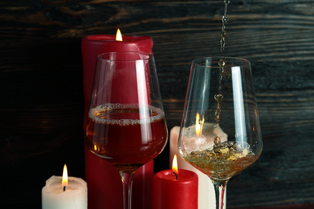 Pouring white wine  into the wineglass
