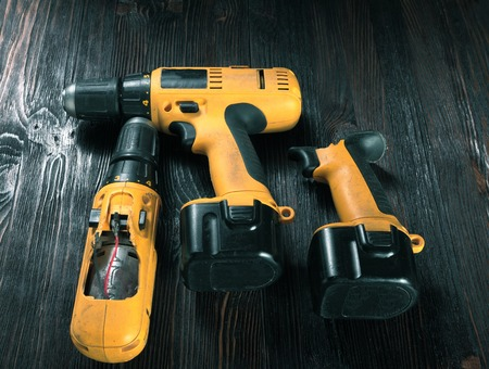 drills: Electric drills on the wooden table