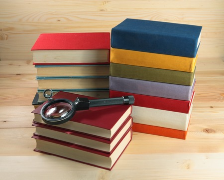 education book: Old books on a wooden shelf.