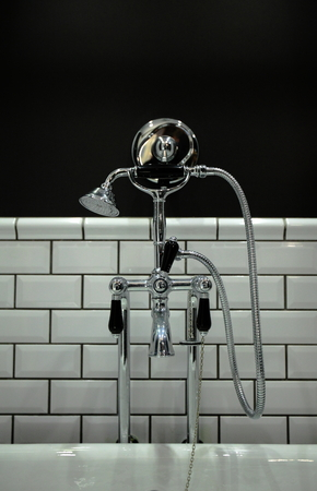 bathroom interior: Old vintage faucet in bathroom interior