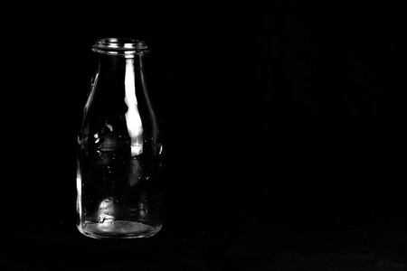 vitreous: Bottle of milk on a black background Stock Photo