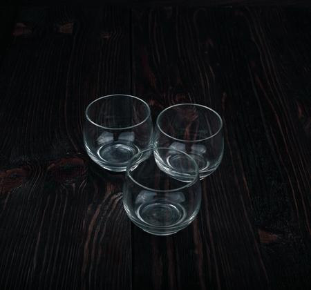 stemware: Stemware with dark wooden background.