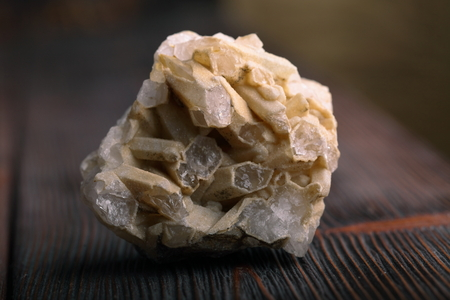 mineral stone: Rock crystal mineral stone on the wooden background. Quartz variety.