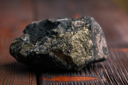 pyrite mineral on the wooden table.