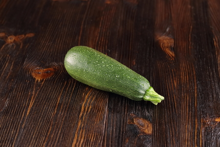 Courgettes on a wooden background.