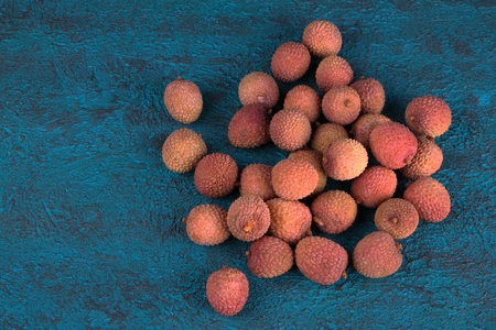 Lychee on a blue cement background