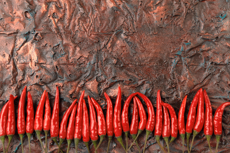 Red Hot chili pepper on a oxidized Copper Sheet. Copper background.