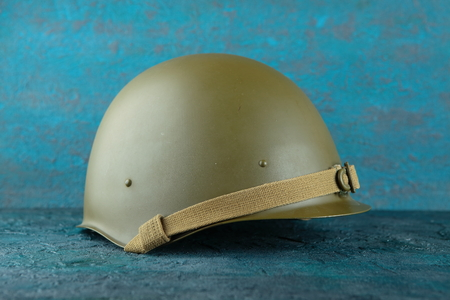 Old military helmet from the Second World War on cement background. Stock Photo
