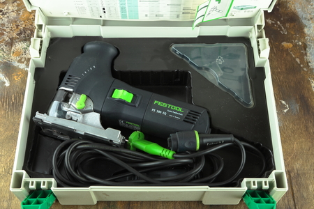 MOSCOW, RUSSIA, AUGUST 15, 2018. Electric jig saw Festool Trion PS 300 EQ on a wooden table against a brick wall.