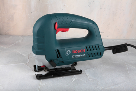 MOSCOW, RUSSIA, AUGUST 30, 2018. Electric jig saw Bosch Professional GST 8000 E against the background of a plastered wall.