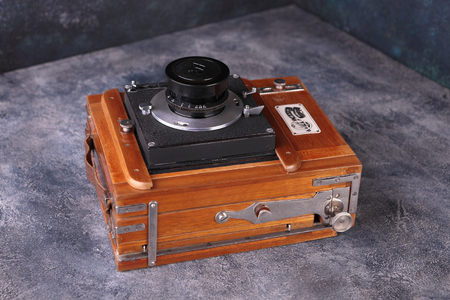 MOSCOW, RUSSIA, FEBRUARY 05, 2019. Vintage wooden camera FKD-13x18 on a cement background. The old studio camera for using plates.