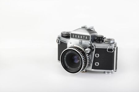 The old German 35 mm SLR film camera Exakta VX 1000 released 1967, with Carl Zeiss lens Tessar 2,8 50 mm lens on a white background. The last of the real camera Exakta. Editorial