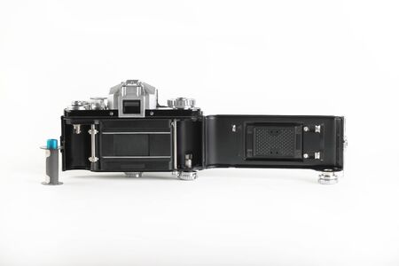 The old German 35 mm SLR film camera with Lens 2,8 50 mm on a white background.