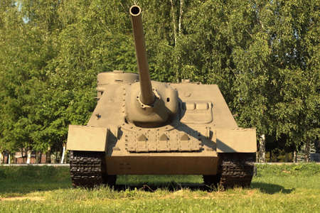 Snegiri village, Istra district, Moscow region, June 26, 2020. Self-propelled artillery installation SU-100 under the trees participated in the 2nd world war, Released in 1945.