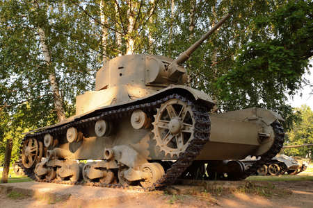 Snegiri village, Istra district, Moscow region, June 26, 2020. Light tank T-26 released in 1933, under the trees, participated in the 2nd world war.