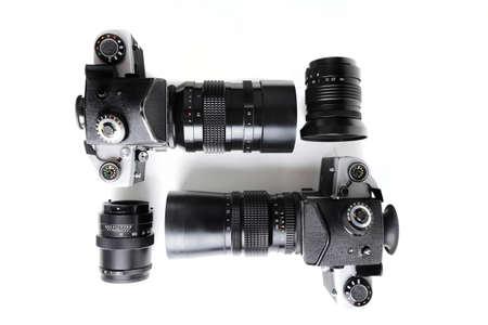 Two old Medium format SLR Film camera with vintage lenses on white background