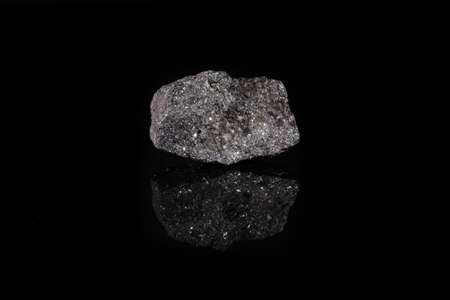 Mineral sphalerite, zinc blende from Zyrianovskoe, Altai, Russia on black glass background. Banque d'images