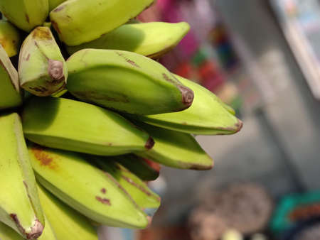 tasty and healthy raw banana bunch with blur background