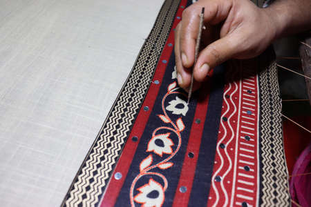 hand craft design on saree with Niddle