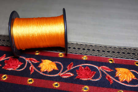 hand craft design on saree with Niddle and yarn reel