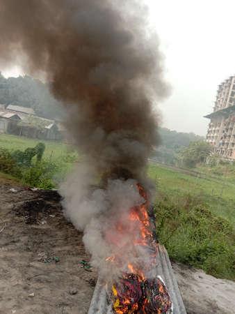 fire scene with black smoke on field