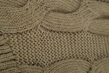yellow colored woolen sweater Knitted fabric closeup for sell
