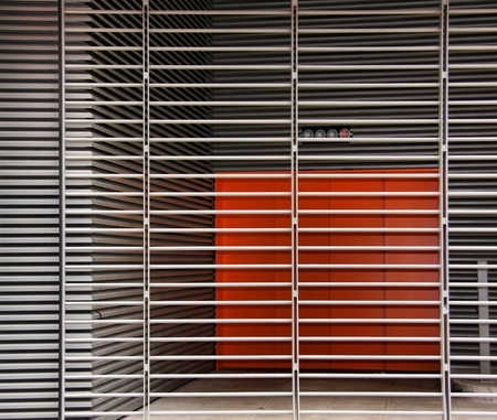 Orange Room behind metal Slats Stock Photo - 10255725