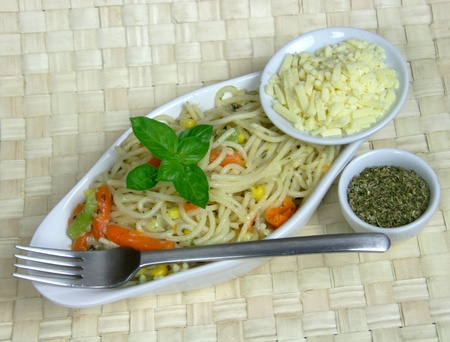 Tasty Vegetarian spaghetti pasta with Basil garnish photo